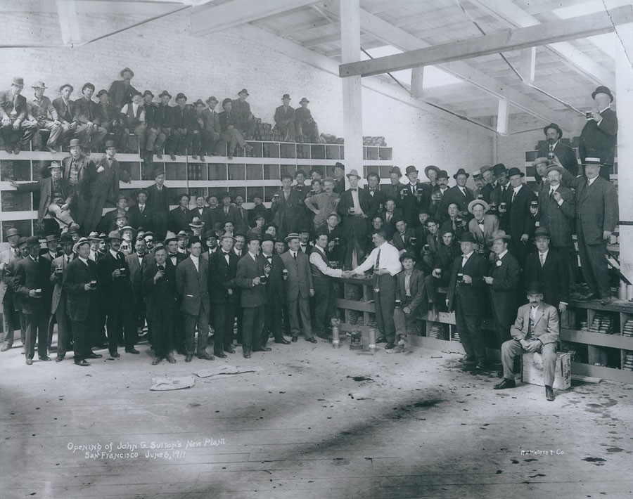 "John G. Sutton (of Scott Co.) plant opening.  June 8, 1911.  Charles ""Noury"" Nurisso, third person standing to the left of the column."